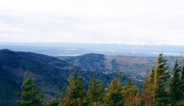 <p>A view of Squak Mountain, Cougar Mountain, and Seattle, seen from the Summit of a peak on Tiger Mountain in King County's Issaquah Alps.</p>