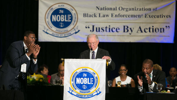 Attendees applaud after Attorney General Jeff Sessions speaks during the National Organization of Black Law Enforcement Executives' 41st annual training conference Tuesday in Atlanta.