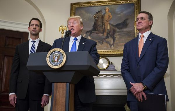 President Trump announces the introduction of the Reforming American Immigration for a Strong Economy (RAISE) Act with Sen. Tom Cotton, R-Ark. (left), and Sen. David Perdue, R-Ga., in the Roosevelt Room at the White House on Wednesday.