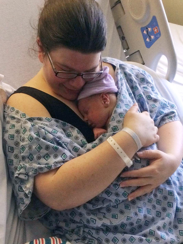 Marie McCausland holds her newborn shortly after delivery. A ProPublica/NPR story about preeclampsia prompted her to seek emergency treatment when she developed symptoms days after giving birth.