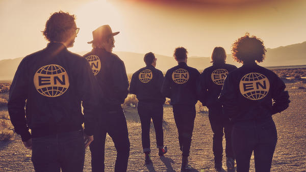 """Despite what the critics might say, Will and Win Butler of Arcade Fire say the band's new album, <em>Everything Now</em>, is """"direct and heartfelt."""""""