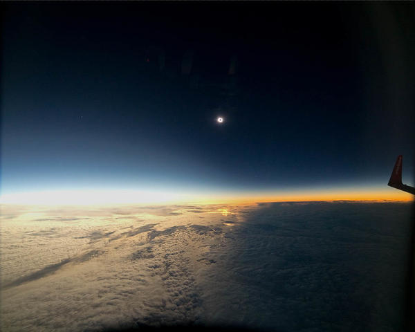 The onset of a solar eclipse on March 20, 2015, is seen from an aircraft flying 35,000 feet over the Norwegian Sea.
