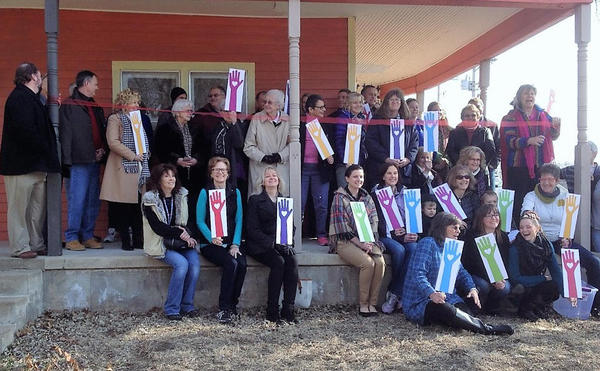 Sister Loretta Jasper cut the ribbon on the Neighbor to Neighbor drop-in center in Abilene, Kansas, in February.