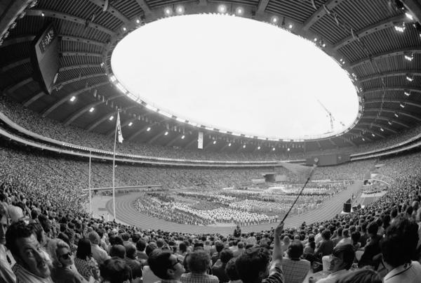 Shown here in 1976, the year Montreal hosted the summer Olympics, this stadium will house the overflow of asylum-seekers. The cots are in a windowless, concrete hallway near the concession stands.