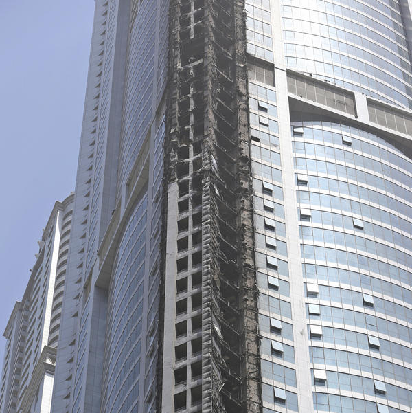 Fire damage is shown on the Torch Tower at Marina district in Dubai, United Arab Emirates, on Friday.