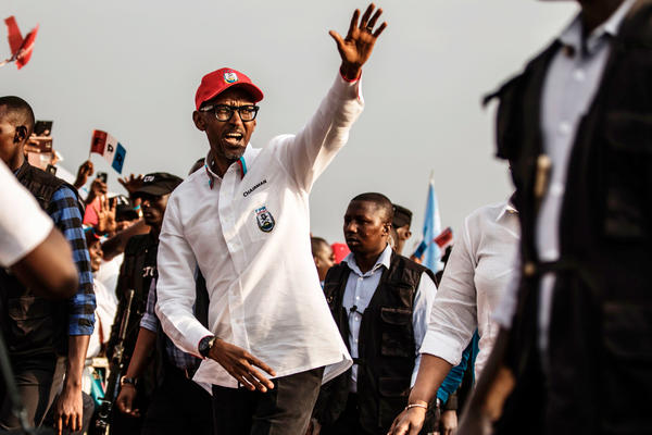 Rwandan President Paul Kagame greets the crowd after addressing supporters at the closing rally of the presidential campaign in the capital, Kigali, this week.