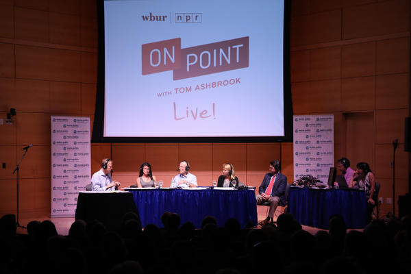 Tom Ashbrook moderates a discussion at the #OnPointLive show in Portland, Maine. (Brian Bechard/Maine Public)