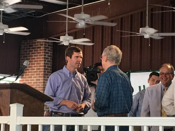 Democratic Attorney General Andy Beshear speaks with Senate Majority Leader Mitch McConnell at Fancy Farm