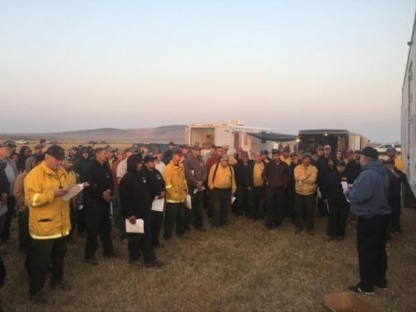 <p>Fire personel at a morning briefing on Aug. 8, 2017.</p>