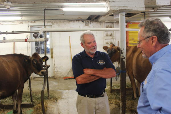 Chuck Luchsinger (center) of Silver Spring Farm talks with New York State Agriculture Commissioner Richard Ball.