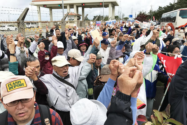 Protesters demonstrate outside a U.S. Marine base on Okinawa. The U.S. plans to greatly expand the base in the rural fishing village of Henoko.