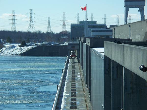 The outflows of water from Lake Ontario through the Moses-Saunders Power Dam and into the St. Lawrence River are going down now that the lake's level has dropped.
