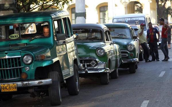 Havana taxi drivers chat while waiting for customers in this archival photo from 2013.