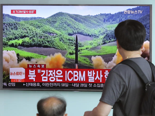 South Koreans watch television coverage of the July 4 launch of a Hwasong-14 intercontinental ballistic missile, ICBM, in North Korea.