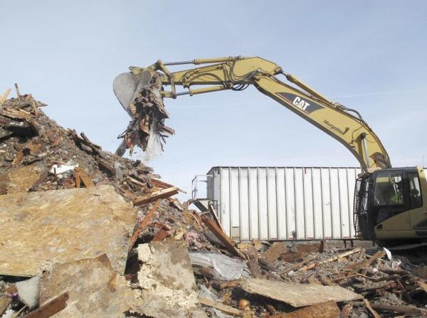 <p>An excavator clears debris from an onion shed in Nyssa, Oregon, that collapsed this winter under the weight of snow and ice.</p>