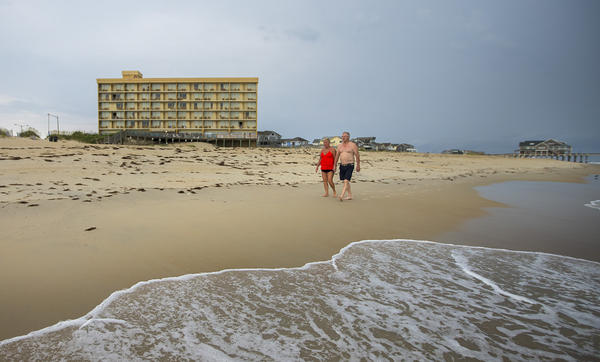 "Orrin Pilkey of Duke University, says this seven-story Comfort Inn, built on Nags Head Beach, is ""a future disaster. The time will come when that will be a good offshore fishing reef."" (Jesse Costa/WBUR)"