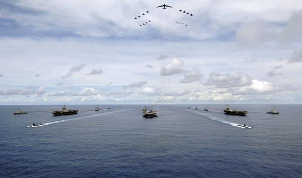 The USS Nimitz, USS Kitty Hawk and USS John C. Stennis carrier strike groups travel in formation during an exercise in 2007 in the Guam operating area.