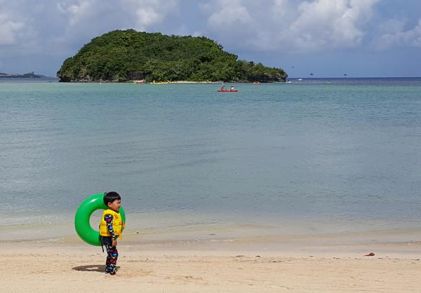 A child plays on a beach in Guam's capital, Hagatna, on July 14. About 163,000 people live on the island.