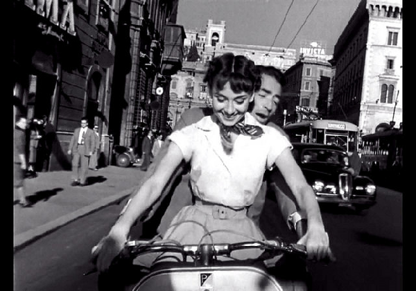 Audrey Hepburn and Gregory Peck in 'Roman Holiday,' a classic vacation movie.