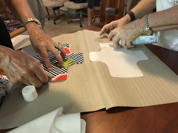 Fort Myers women are pasting a kind of plastic liner to the pre-cut cotton shields. It's to prevent any period flow getting through the pads.