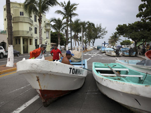 Fishermen move their boats, normally moored in the Gulf of Mexico, onto a coastal road to protect them ahead of the arrival of Tropical Storm Franklin, in the port city of Veracruz, Mexico, on Wednesday.