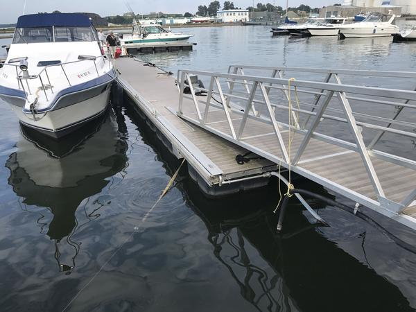 This dock detached from the Oswego International Marina during a recent storm that produced 11-foot-high waves. The historically high water levels on Lake Ontario this year have taken a toll on Oswego and many other municipalities along the shoreline.