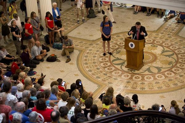 In a file photo, state Sen. Mark Pacheco addresses pipeline protesters in the State House. (Jesse Costa/WBUR)