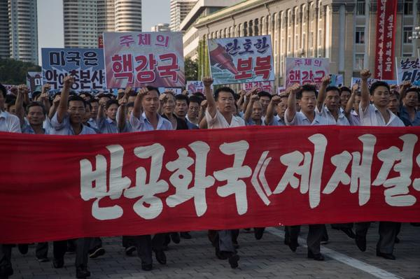 People wave banners and shout slogans as they attend a rally in support of North Korea's stance against the U.S., in Pyongyang on Aug. 9, 2017. (Kim Won-Jin/AFP/Getty Images)