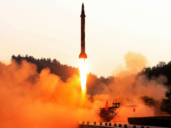 North Korea's official Korean Central News Agency released photo of a ballistic missile test at an undisclosed location.