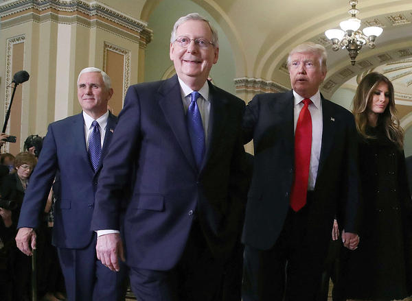 The relationship between Senate Majority Leader Mitch McConnell and President Donald Trump (seen here in friendlier times — November, 2016), soured this week over disputes about the failure of legislation repealing the Affordable Care Act.