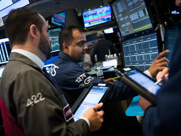 Traders and financial professionals work the floor of the New York Stock Exchange ahead of the opening bell on Friday.