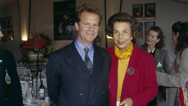 Liliane Bettencourt and François-Marie Banier attend a cosmetics industry event in 1992.