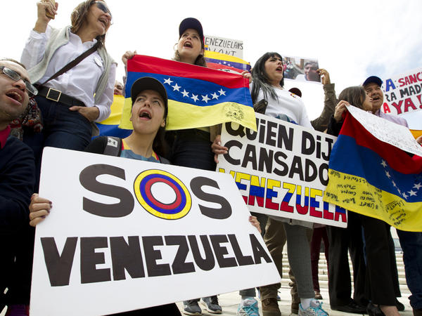 Demonstrators protest President Nicolas Maduro's moves to consolidate his power outside a special meeting of the Organization of American States in Washington on Apr. 3.