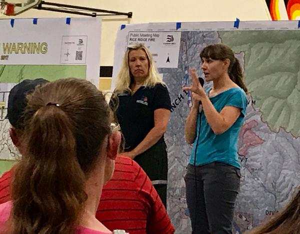 Sarah Coefield from the Missoula City-County Health Department talks about the hazards of the smoke in Seeley Lake at a public meeting Thursday, August 10, 2017.