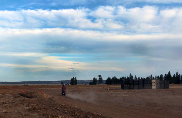 <p>A worker drives off in the direction of the main event area and the Big Summit Prairie.</p>