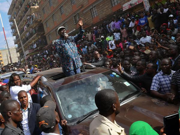 "Kenyan opposition leader Raila Odinga arrives in Nairobi's Mathare district to speak with supporters Sunday. According to official results, Odinga was defeated by President Uhuru Kenyatta — but Odinga has decried those results as a ""fraud."""
