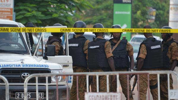 Burkinabe police gather in Burkina Faso's capital city, Ouagadougou, on Monday after an assault by gunmen killed 18 people.