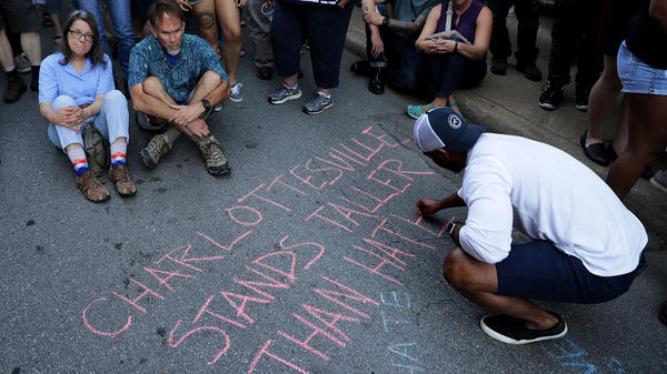 "Hundreds of people gather for a vigil on the spot where 32-year-old Heather Heyer was killed when a car plowed into a crowd of people protesting against the white supremacist ""Unite the Right"" rally in Charlottesville, Va."