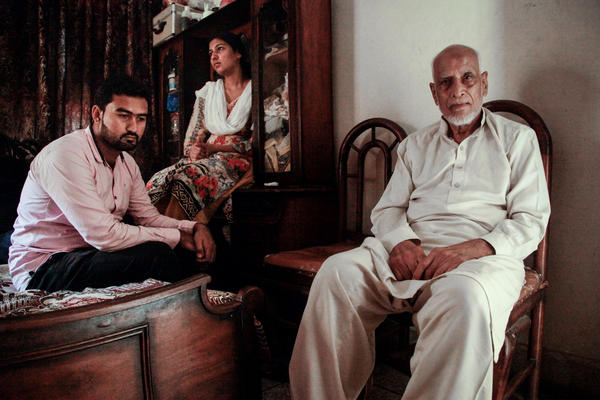 As a boy in 1947, Muhammad Hanif Qureshi — now 83 and shown here with his great-niece and great-nephew in their home in Lahore — fled Amritsar. The area encompassing Amritsar and Lahore saw some of the worst violence of Partition.