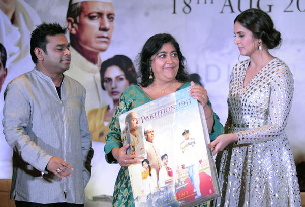 """Indian Bollywood actress Huma Qureshi (right) and film score composer and singer A.R. Rahman (left) take part in a promotional event for the forthcoming Hindi film """"Partition 1947"""" directed by Gurinder Chadha (center) in Mumbai on July 4, 2017. (STR/AFP/Getty Images)"""