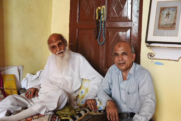 107-year-old Mirza Naseem Changezi (left) sits with his son Khalid Changezi, 61, at their home in the Old City of New Delhi. Changezi is reputed to be the Old City's oldest resident and says there was never any question of leaving India for Pakistan. The Changezis trace their roots back 23 generations.