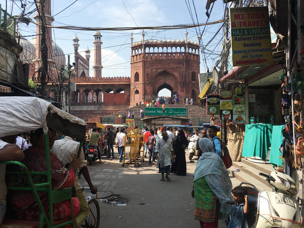 A street in Old Delhi leads to one of the four gates of the Jama Masjid, the grand 17th century mosque built by the Mughal Emperor Shah Jahan. The Old City is a Muslim enclave of the capital and a site of unrest during the Partition.