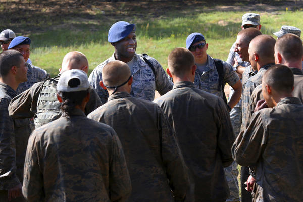 """Brian Kelly (center) chats with younger cadets who just endured the Air Force Academy assault course. A former air-traffic controller, Kelly is now the oldest cadet at the Air Force Academy. When he arrived, he says, he and other older cadets would wonder, """"What are we doing here? We were 22 or 23, had a house, had a car, had a dog."""""""