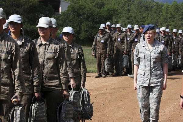 """Monica Callan (right) marches with first-year cadets. Callan has seven years on these 18-year-old cadets, who have nicknamed her """"Mom-ica"""" and who she calls """"my kids."""""""