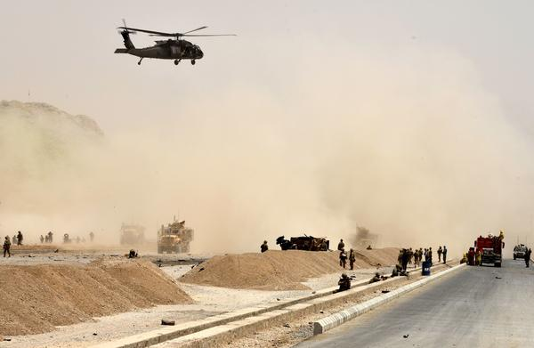 A Black Hawk helicopter flies over the site of a Taliban suicide attack in Kandahar, Afghanistan, on Aug. 2.