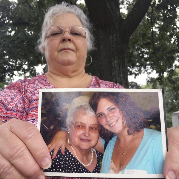 Susan Bro, the mother of Heather Heyer, holds a photo of Bro's mother and her daughter. Heyer was killed Saturday when police say a man plowed his car into a group of demonstrators protesting the white nationalist rally.