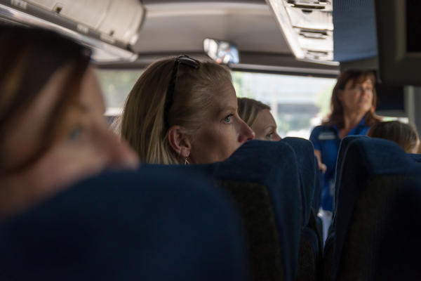 Ashley Lock peers out of the window during a district bus tour for new teachers at Ladue Horton Watkins High School, where she'll teach history.