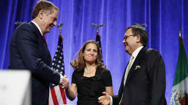 U.S. Trade Representative Robert Lighthizer (left) shakes hands with Canadian Foreign Affairs Minister Chrystia Freeland, accompanied by Mexico's Secretary of Economy Ildefonso Guajardo, after they spoke at a news conference Wednesday at the start of NAFTA renegotiations in Washington, D.C.