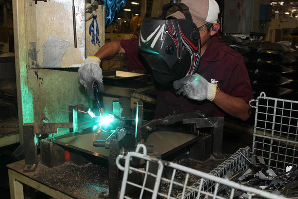 Alberto Martinez welds steel at a maquila owned by Metal Industries Inc. The sector has grown since NAFTA began in 1994, leaving many maquilas short of workers.