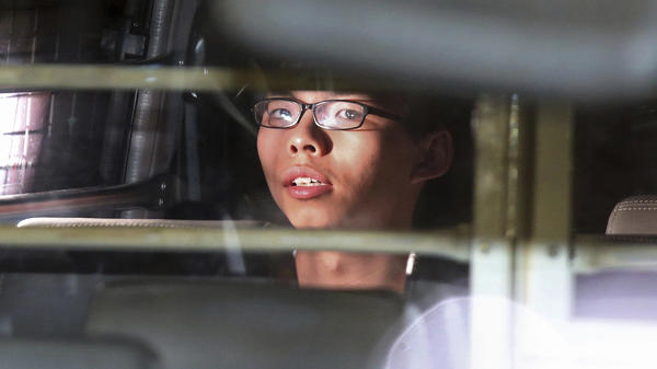 Joshua Wong, seen in the prison bus after his sentencing in Hong Kong on Thursday.